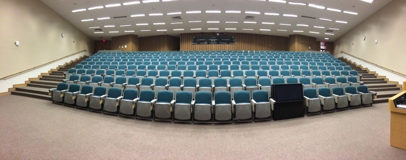 Auditorium with many empty rows of seats